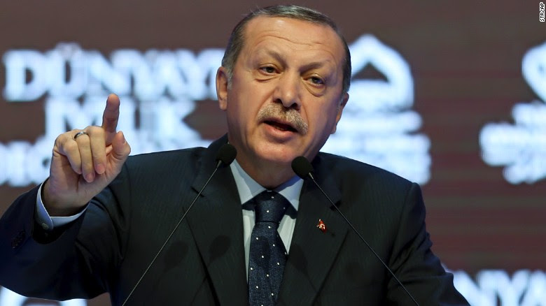 "Turkey's President Recep Tayyip Erdogan talks during a rally in Istanbul, Sunday, March 12, 2017. The escalating dispute between Turkey and the Netherlands spilled over into Sunday, with a Turkish minister unable to enter her consulate after the authorities there had already blocked a visit by the foreign minister, prompting Erdogan to call the Dutch fascists. Erdogan said at the rally: ""I had said that Nazism has risen from the grave. I said 'I thought Nazism was over but I was wrong.' In fact, Nazism is alive in the West."" (AP Photo}"