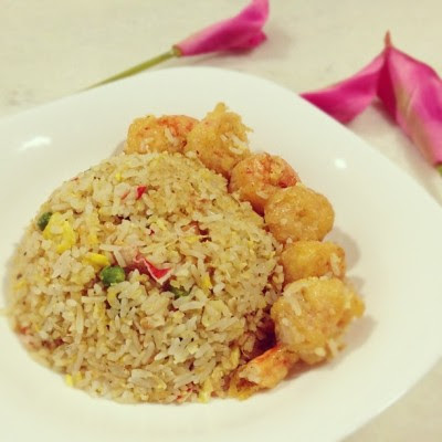 Fried rice with battered prawns for the folks while I enjoy my… Congee. T^T #sucktobesick  (Taken with Instagram)