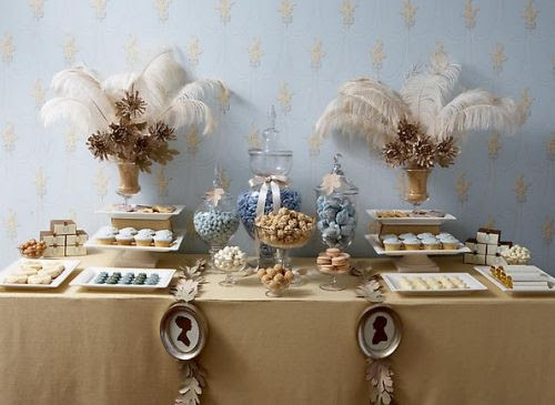 dessert table with ivory feathers and gold and light blue accents