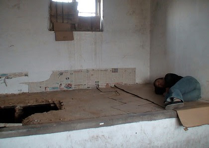 In the black jail ... Liu sleeping in her cell during her imprisonment.
