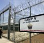 A guard enters the main gate of Camp 5, a maximum security facility at Camp Delta at the U.S. Naval Base Guantanamo Bay, Cuba July 28, 2004. The prison can hold 100 of the highest risk detainees. Preparations are nearing completion on the Naval base for war crimes tribunals, the first held by the United States since the World War II era. The proceedings are expected to begin within months. U.S. military censors reviewed photographs from the prison.        REUTERS/Joe Skipper