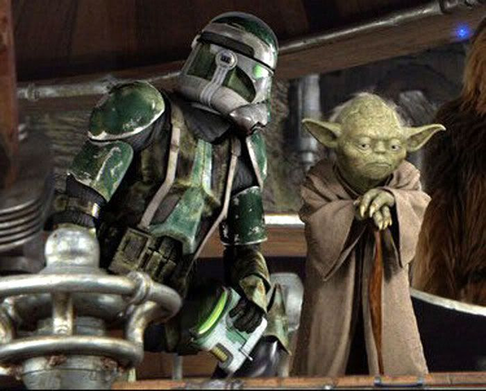 A clone commander reports to Yoda during the Battle of Kashyyyk.