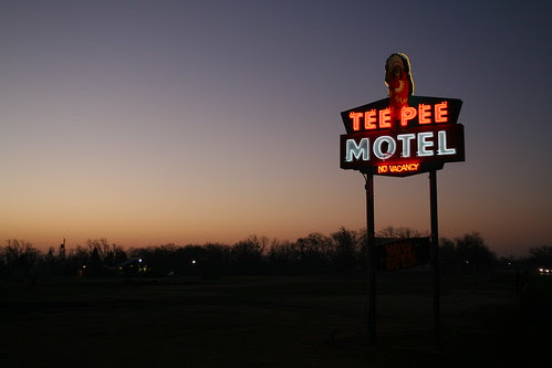 tee pee motel sign with sun just rising