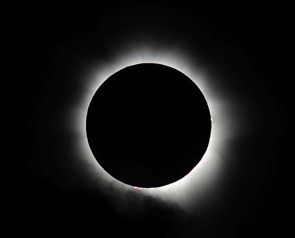 Totality is seen during the solar eclipse at Palm Cove on November 14, 2012 in Palm Cove, Australia. Thousands of eclipse-watchers have gathered in part of North Queensland to enjoy the solar eclipse, the first in Australia in a decade. Photo: Ian Hitchcock, Getty Images / SF