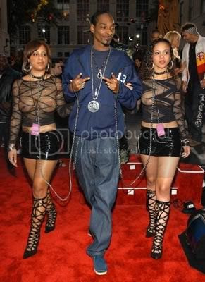 Snoop Dogg Walking Women On Dog Leashes