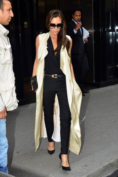 Victoria Beckham heads out of the British embassy after attending a lunch with British Ambassador Peter Ricketts and other personalities during the Fashion Week in Paris.