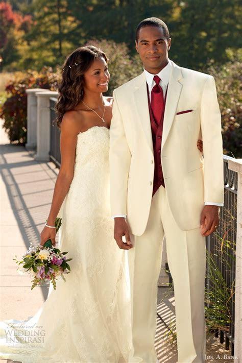 Troy Ivory Tuxedo with rich burgundy vest, tie, & pocket