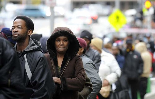 In a desperate attempt to get relief, 50,000 people lined up outside Cobo Conference Center in Detroit to pick up applications for utility and mortgage assistance that will only provide relief for 3,500. The economic crisis in capitalism is worsening. by Pan-African News Wire File Photos