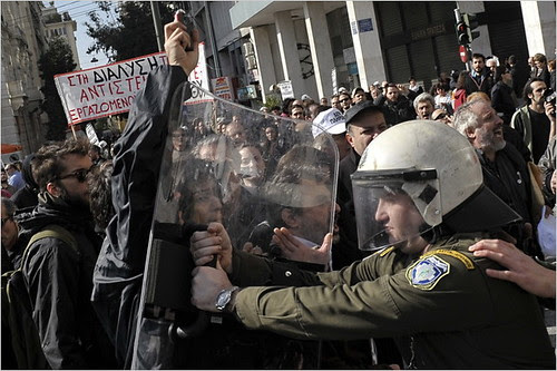 Greece police attack protesters who are demonstrating against the economic crisis affecting the country. The European Union has demanded larger cuts in salaries and services in exchange for assistance to the beleagured state. by Pan-African News Wire File Photos