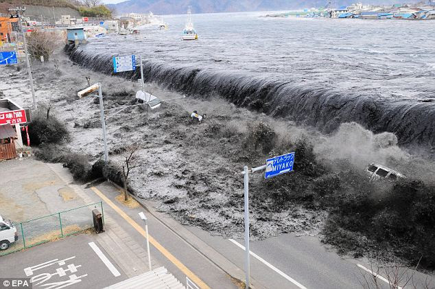 Is the U.S. next? Waves overwhelm a levee, swallowing a seaside village near the mouth of Hei River after a tsunami and an earthquake hit Japan
