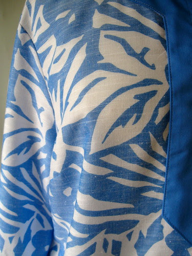 blue tunic fabric close up