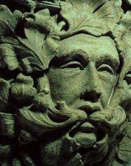 """The Green Man, Hauntingly wise Green Man """"speaking"""" in hawthorn leaves, Parish Church in Sutton Benger, UK   (c.1300)"""