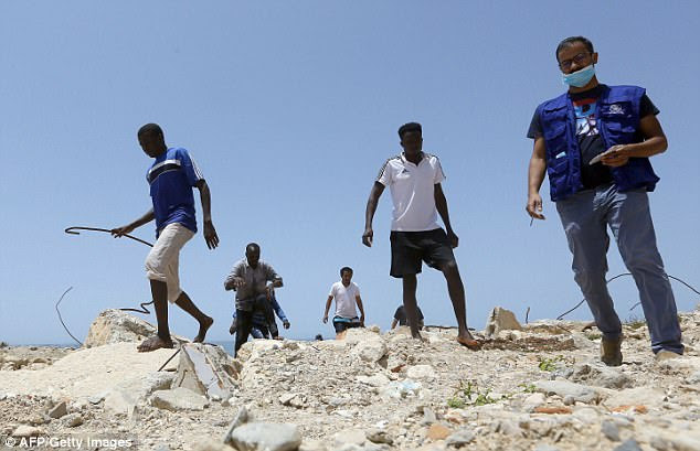 The latest shipwreck came after European Union leaders reached a deal aimed at sharing the responsibility for hosting migrants more fairly across the bloc. Pictured: The scene in Libya after the sinking