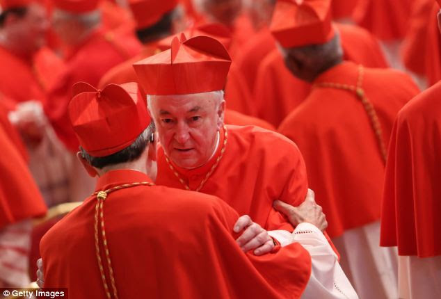 Archbishop of Westminster Vincent Nichols receives congratulations from cardinals as he attends the Consistory at St Peter's Basilica