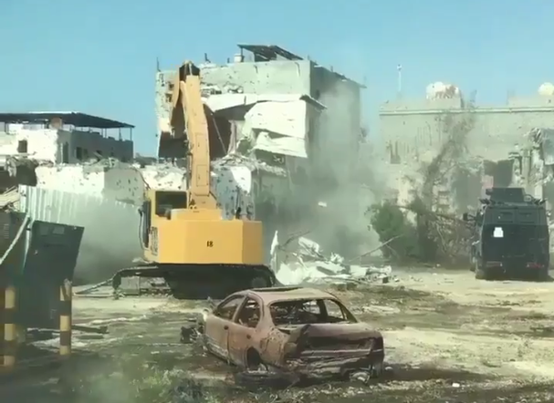 A screengrab appears to show bullet-ridden buildings demolished by bulldozers in Qatif (@AngryQatifi)