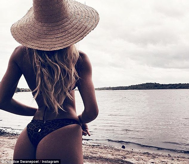 Peachy! Candice Swanepoel excited her Instagram followers with a sexy snap from her time in her native South Africa on Wednesday, in which she revealed most of her derriere in a pair of tiny bikini bottoms