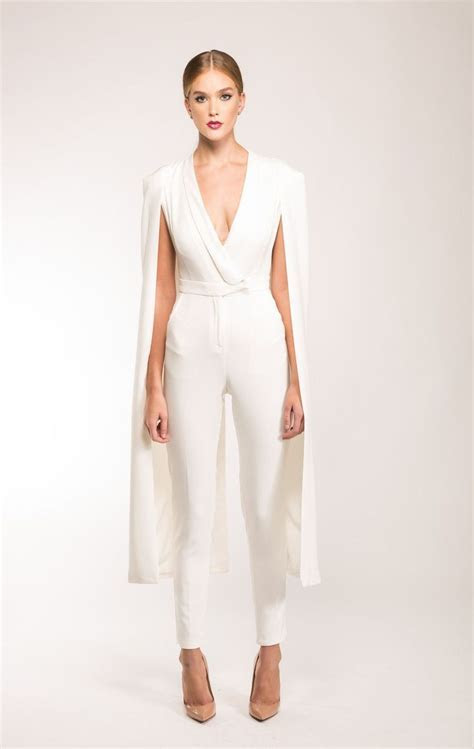 Own it in our Luxe Off White Cape Jumpsuit. Tailored to