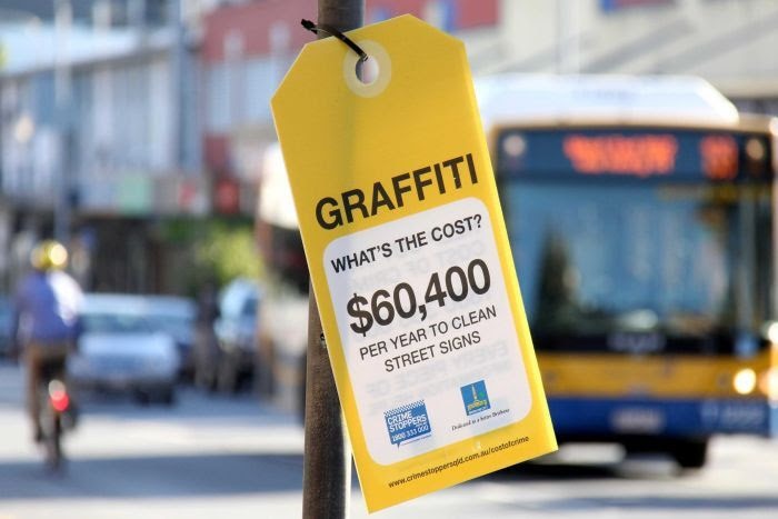 One of the graffiti 'price tags' hanging from Brisbane City Council assets in Brisbane's West End.