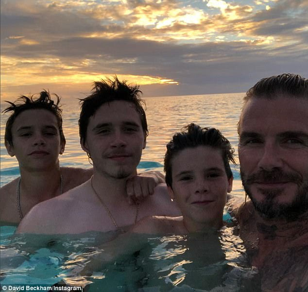 David Beckham shares sunset snap with his lookalike sons as they vacation in Florida
