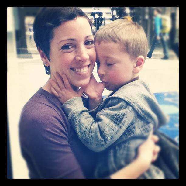 Zach took this pic right after D ran up to greet me at the airport on Monday. =)