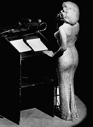 "Marilyn singing ""Happy Birthday Mr. President"" to JFK on May 19th 1962. In this iconic moment in U.S. History, Monroe sings to the President in a sultry voice while wearing a skin-tight dress with nothing under it. When one knows the ""hidden side of History"" this event was actually a Beta Programming slave singing to the President she is servicing for the whole world to see."