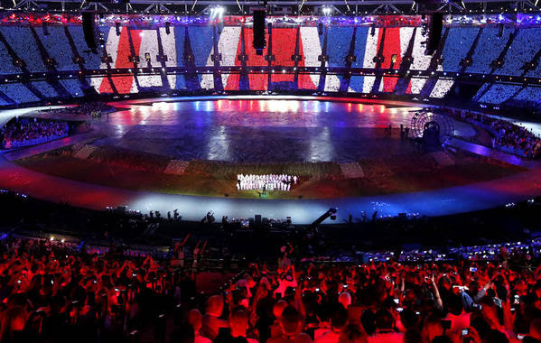 The colors of the Union Jack flag are highlighted  Friday during the opening ceremony of the London 2012 Olympic Games.