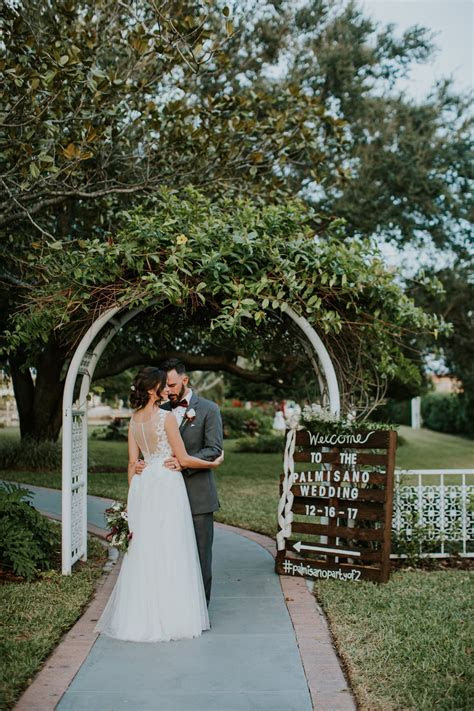 Outdoor Bride and Groom Wedding Portrait. White Arch and