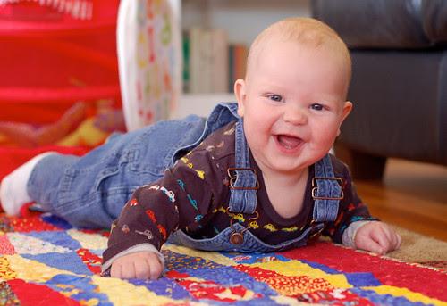 Happy boy in overalls