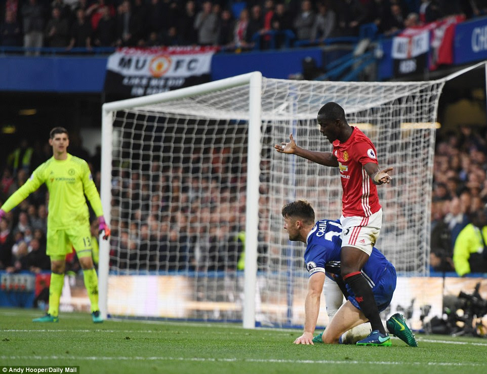 Cahill and Bailly become entangled in the Chelsea box as Manchester United try to get back into the match