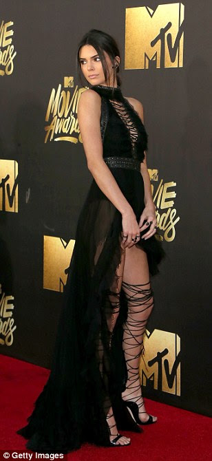 Leggy look: Kendall Jenner stunned in a halterneck gown with sexy lace-up stilettos