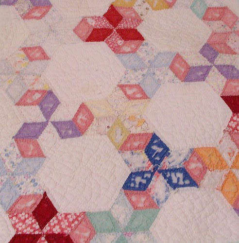pretty pattern on old quilt