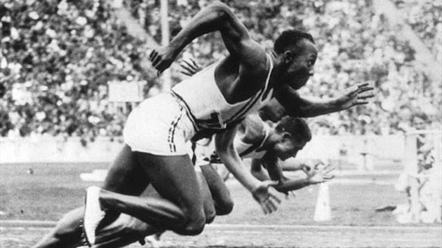 Jesse Owens starts the 100m at the 1936 Olympics in Berlin