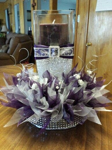 Wedding center peice with plum and silver organza ribbon
