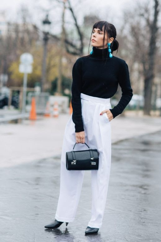 Le Fashion Blog Fashion Week Statement Earrings Black Turtleneck White High Waist Trousers Black Heeled Boots Via Sandra Semburg