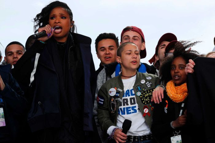 Jennifer Hudson is seen singing on stage next to teenage survivors of Parkland, Florida school shooting.