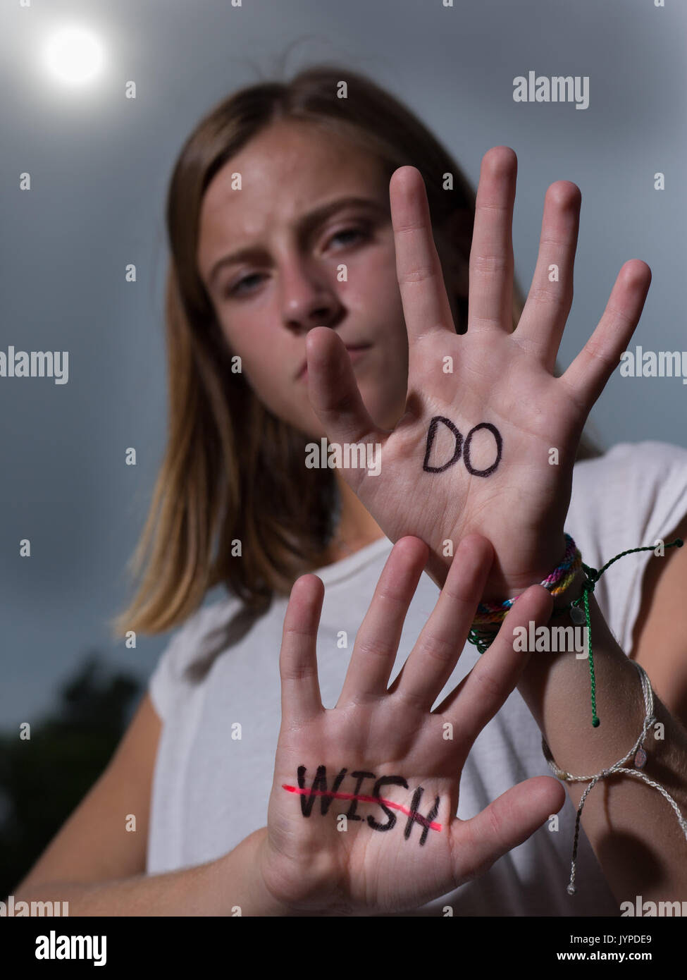 Teenage Girl Hold Up Hands With Motivational Quotes Written On Palms