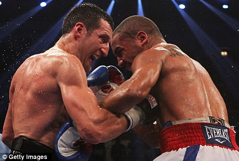 Beaten: Froch (left) was defeated by the astute Andre Ward (right)