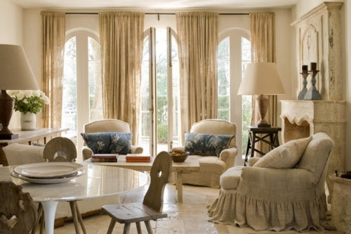 Living-room-decorating-ideas-home-decor-natural-colors-neutral-beige-tall-windows-curtain-panels-elegant-ruffle-skirt-chair-blue-accents_large