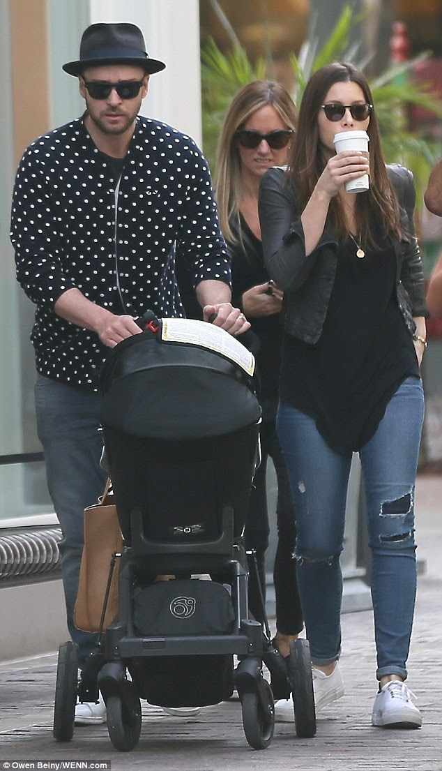 Post-baby-body envy: The A-Team actress looked slim in her blue ripped jeans which she turned up
