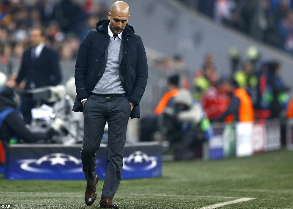 Bayern Munich manager Pep Guardiola looks dejected with his side trailing to Italian giants Juventus midway through the first half