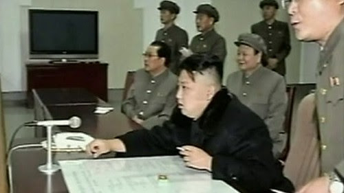Democratic People's Republic of Korea (DPRK) leader Kim Jong-un watches the historic launch of a satellite in Pyongyang. The pioneering effort sent shockwaves through the imperialist states. by Pan-African News Wire File Photos