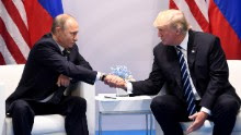 US President Donald Trump and Russia's President Vladimir Putin shake hands during a meeting on the sidelines of the G20 Summit in Hamburg, Germany, on July 7, 2017. (SAUL LOEB/AFP/Getty Images)