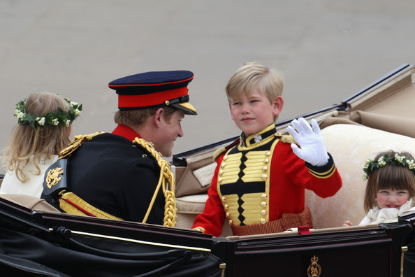 Prince Harry, page boy Tom Pettifer and bridesmaid Eliza Lopes (R) make the journey by carriage procession to Buckingham Palace following their marriage at Westminster Abbey on April 29, 2011 in London, England. The marriage of the second in line to the British throne was led by the Archbishop of Canterbury and was attended by 1900 guests, including foreign Royal family members and heads of state. Thousands of well-wishers from around the world have also flocked to London to witness the spectacle and pageantry of the Royal Wedding.