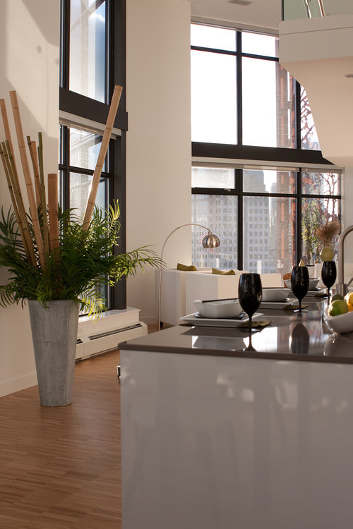 large vase with greenery and sticks kitchen