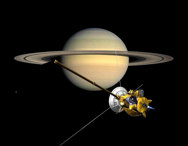 A composite image showing the Cassini spacecraft orbiting Saturn.
