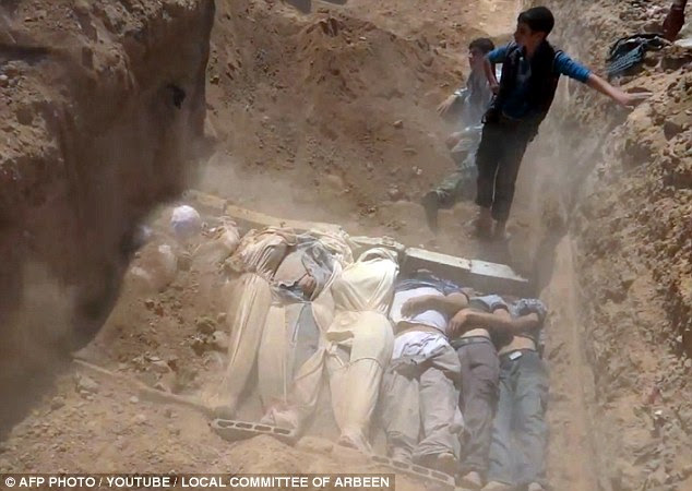 An image grab taken from a video uploaded on YouTube August 21 allegedly shows a mass grave containing bodies of victims that Syrian rebels claim were killed in a toxic gas attack by pro-government forces in eastern Ghouta and Zamalka