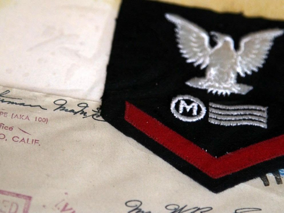 PHOTO: Loyd Leatherman, 91, served as a mailman aboard the USS Oglethorpe during WWII. He kept his uniform patch and many of the letters he had sent home while deployed.