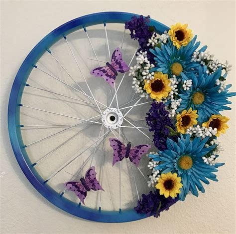 Floral butterfly bicycle wheel wreath for spring; Just
