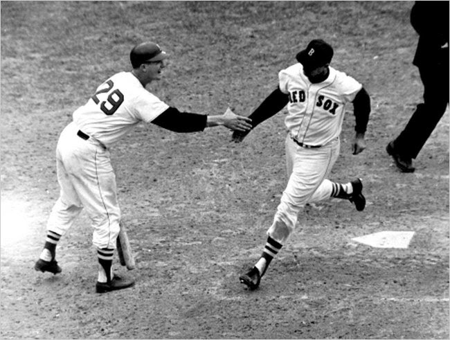 'Ted Williams crossing home plate after hitting a homer in his last at-bat.'
