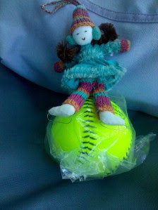 doll with softball